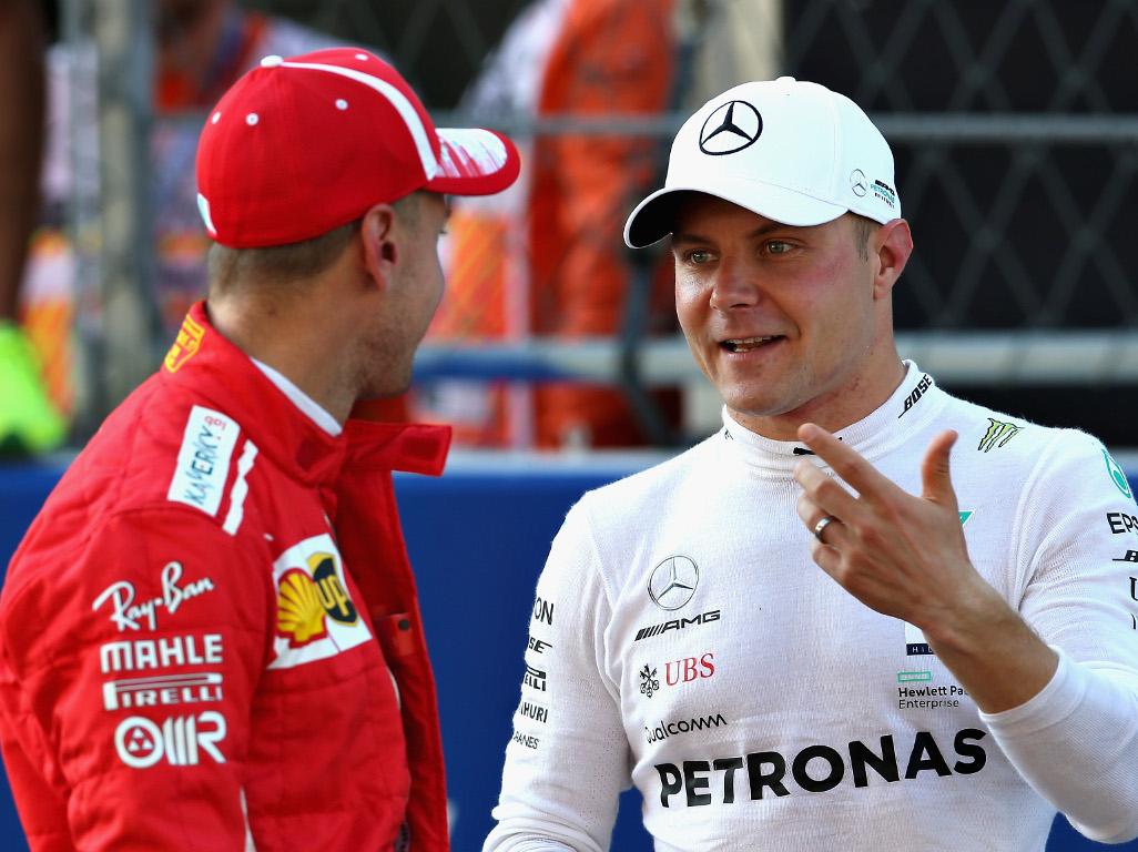 Sebastian-Vettel-and-Valtteri-Bottas