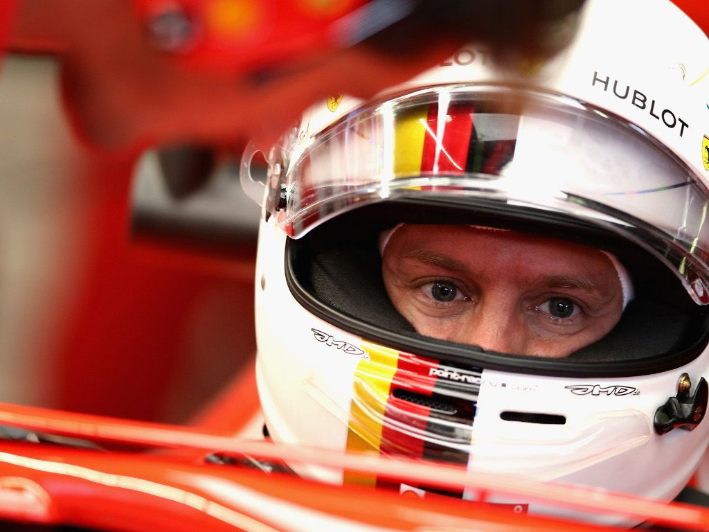 Sebastian Vettel tries out his 2019 office chair