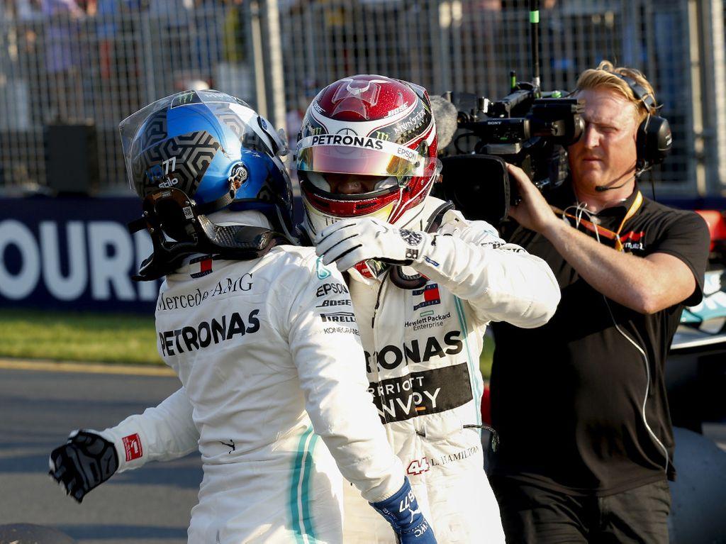 Lewis Hamilton and Valtteri Bottas hug PA
