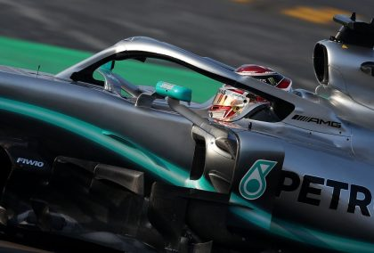 Lewis Hamilton holds off Vettel to claim first P1