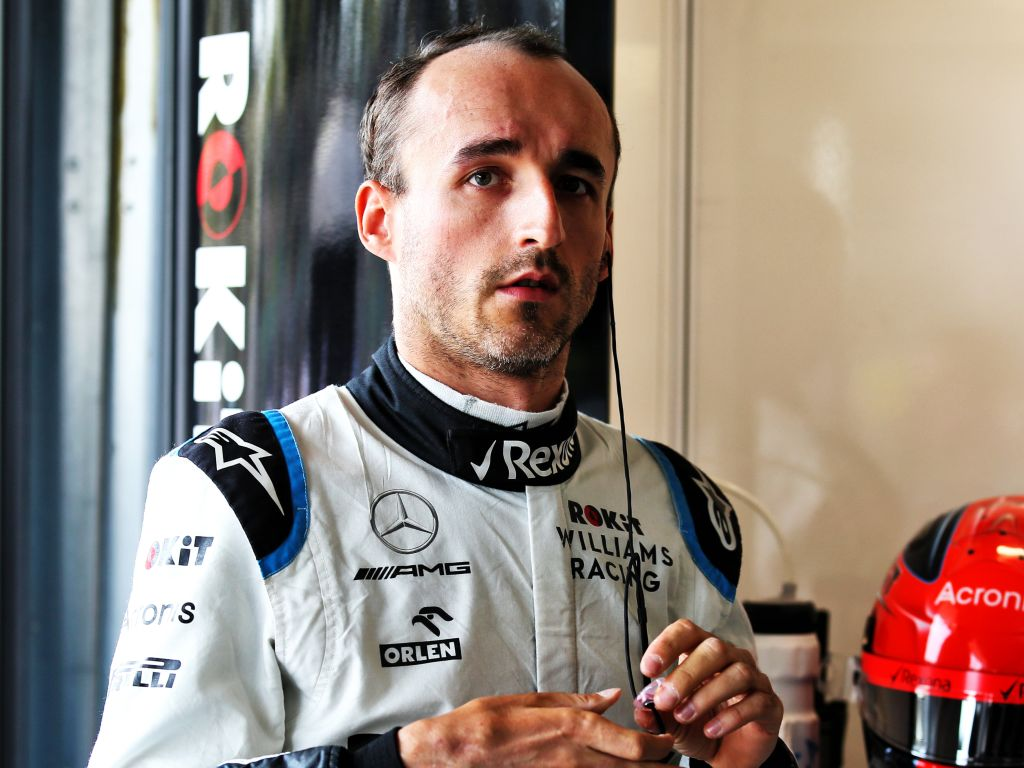 Robert Kubica says Williams distracted him with steering wheel alterations when George Russell overtook him at the Spanish GP.
