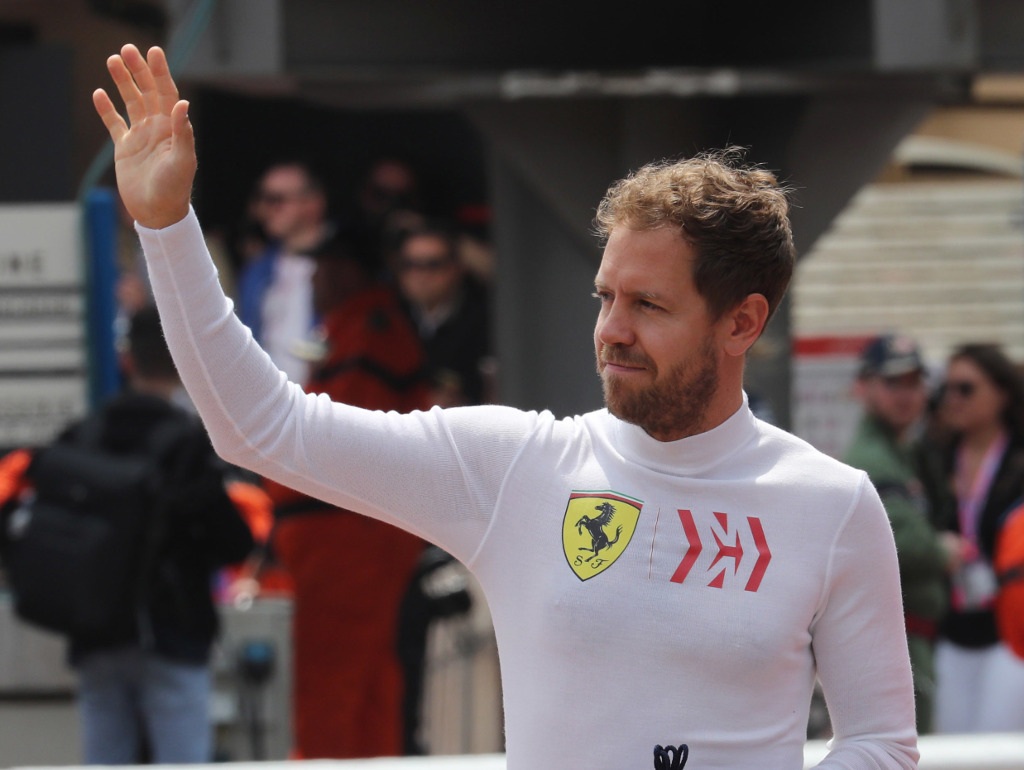 Sebastian-Vettel-waves-PA