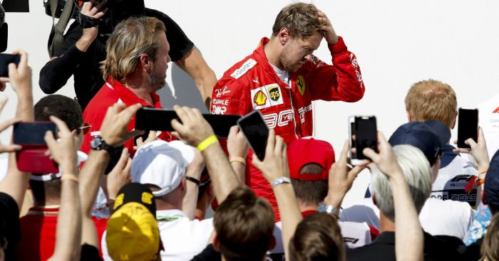 Sebastian-Vettel-head-in-hands-PA