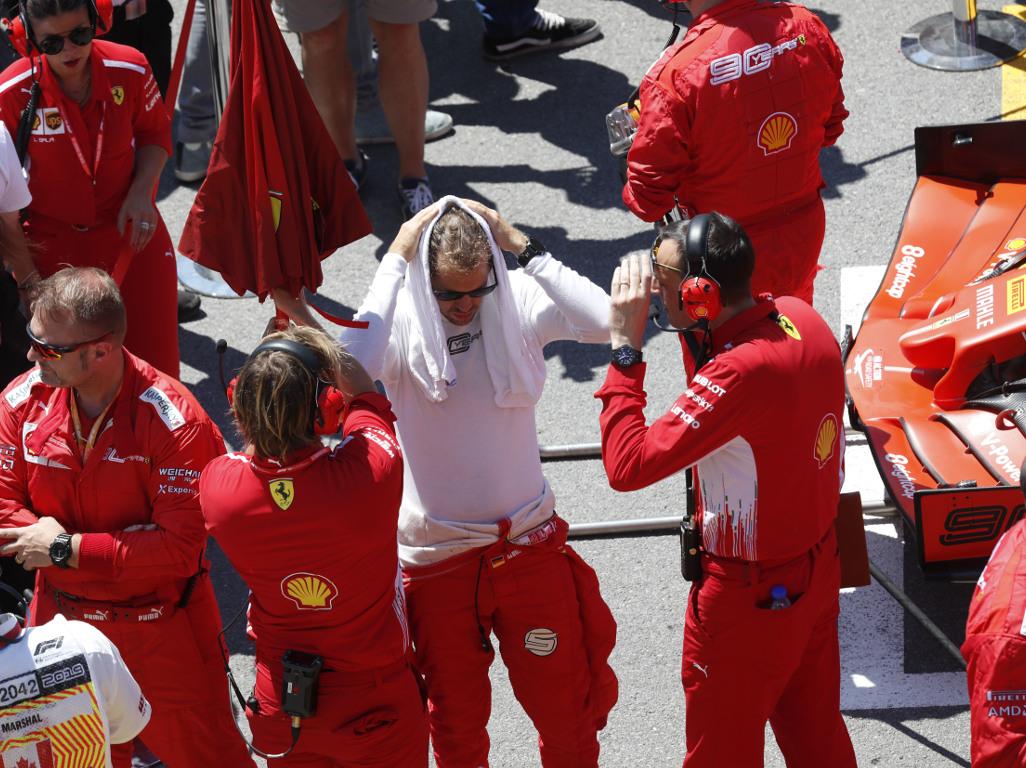 Sebastian-Vettel-head-in-towel-PA