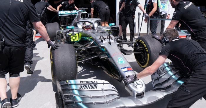 LLewis-Hamilton-pushed-back-into-garage-PA