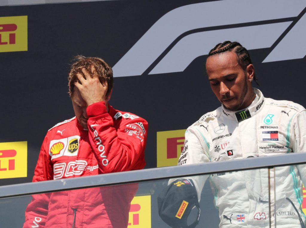 Sebastian-Vettel-heads-in-hands-Lewis-Hamilton-PA