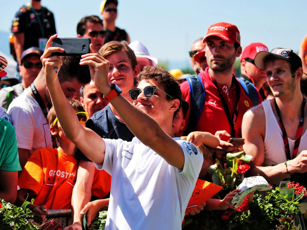 Lando Norris thinks his use of social media gives fans a new insight into F1 behind the scenes.
