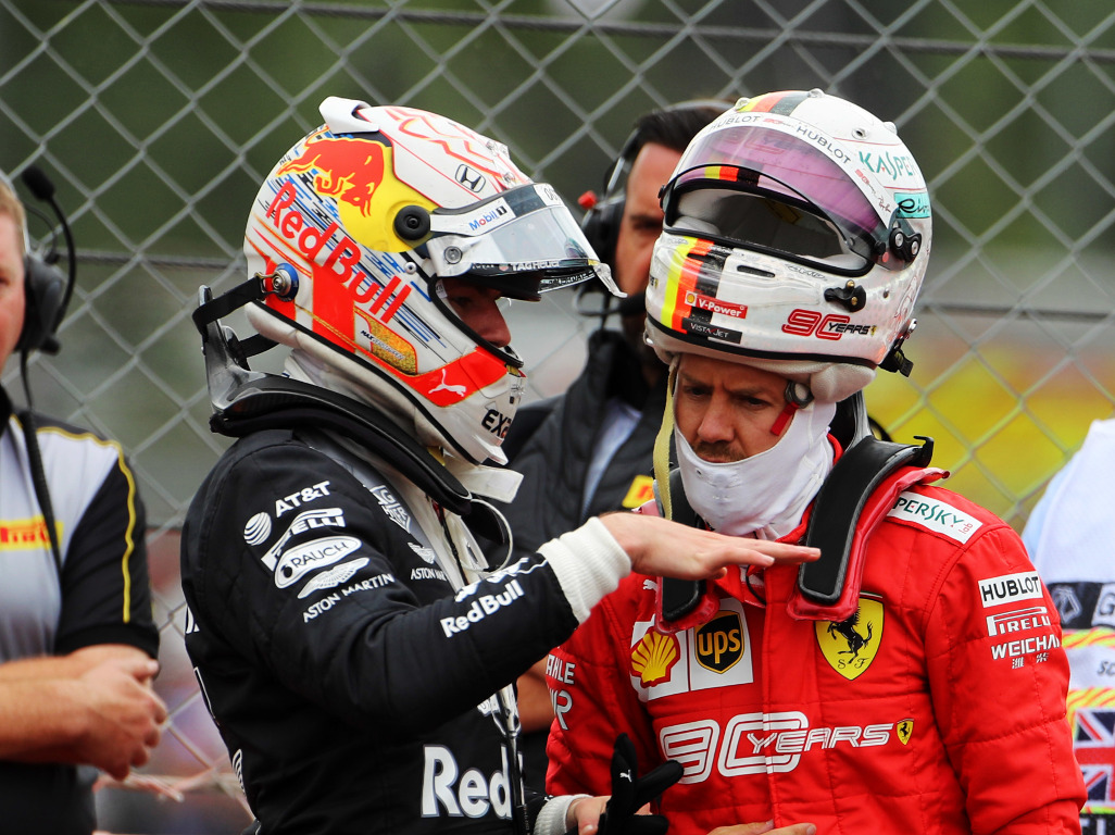 Sebastian-Vettel-and-Max-Verstappen-talking-PA