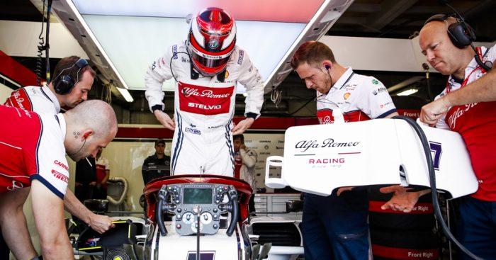 Kimi Raikkonen climbing into his car