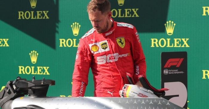 Sebastian-Vettel-checks-out-Mercedes-PA
