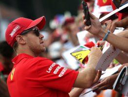 Sebastian-Vettel-signing-autographs-PA