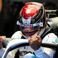 Lewis Hamilton getting into the cockpit