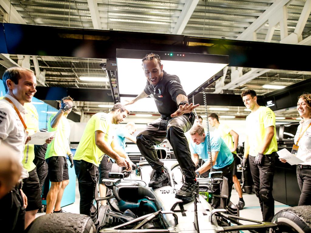 Lewis Hamilton surfing on his car