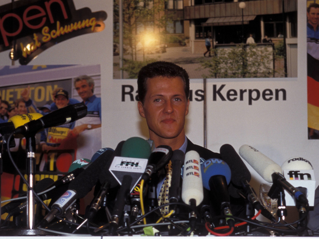 Michael Schumacher talking to the press