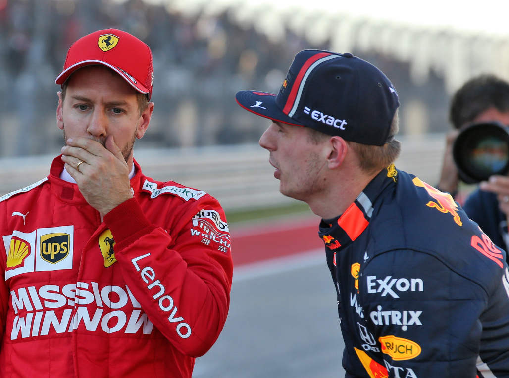 Sebastian-Vettel-hand-over-mouth-and-Max-Verstappen-PA