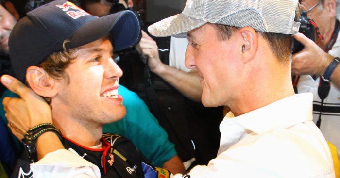 Michael Schumacher congratulates Sebastian Vettel