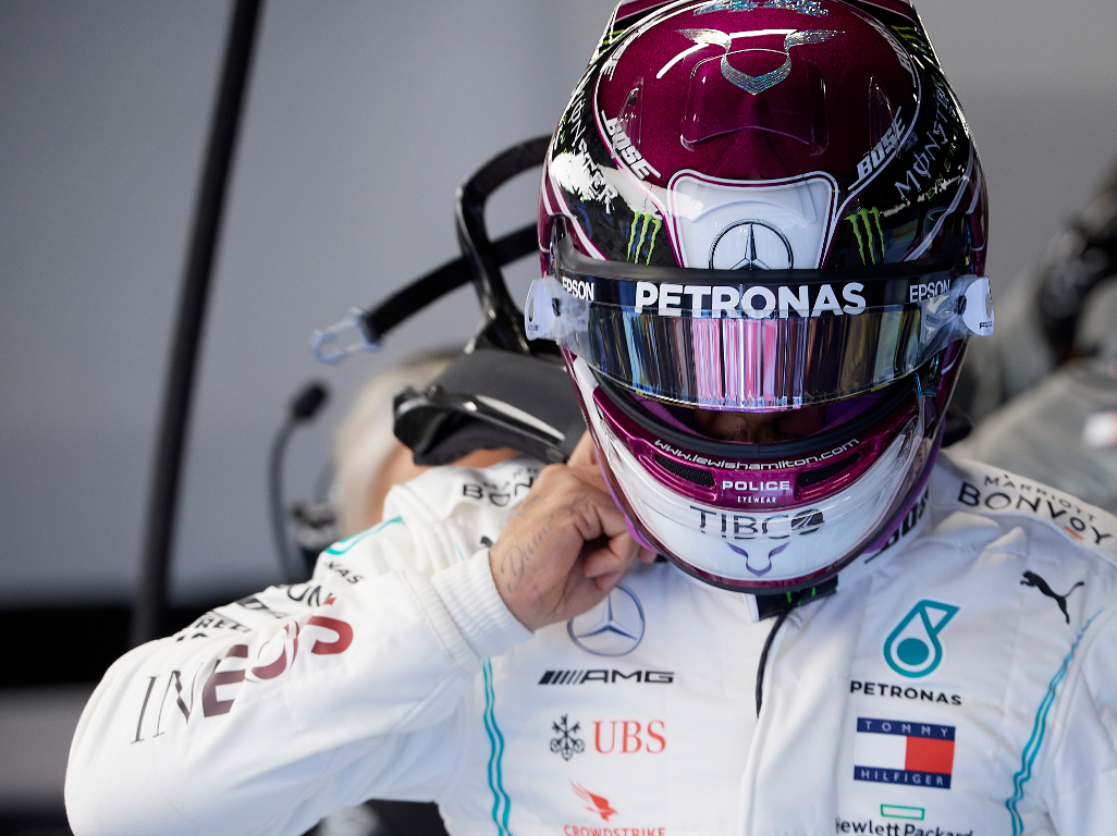 Lewis-Hamilton-in-his-purple-helmet-in-garage