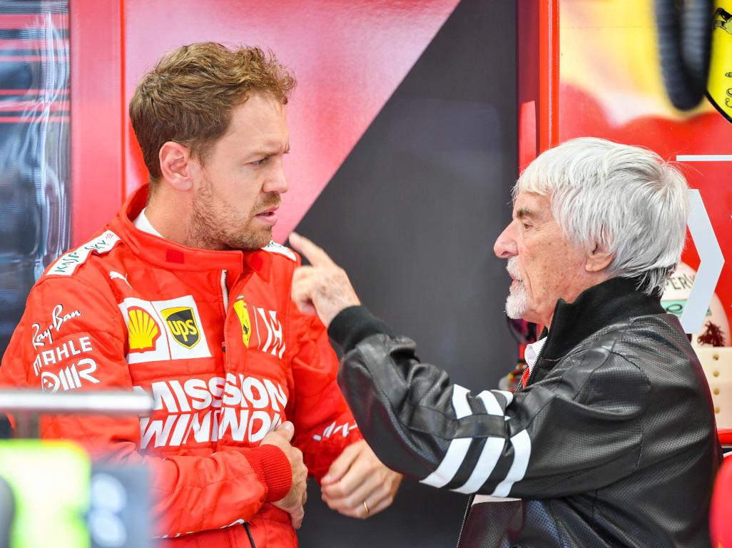 Bernie Ecclestone and Sebastian Vettel pa