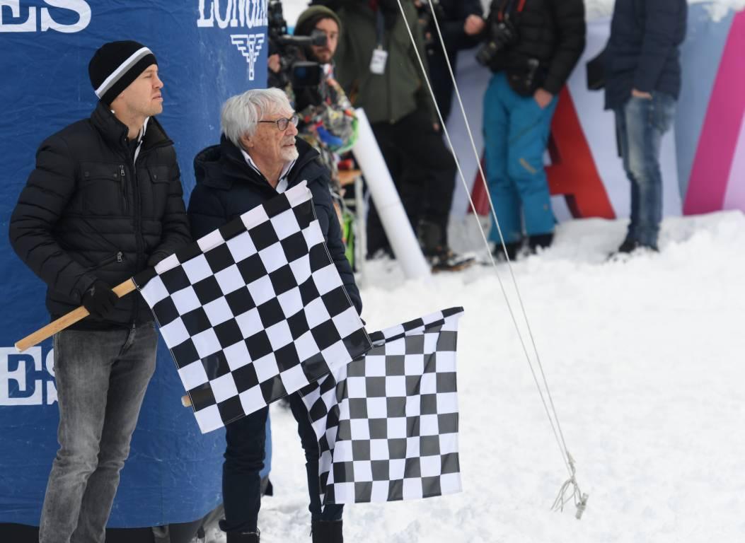 Sebastian Vettel (left) and Bernie Ecclestone at a ski race in Austria
