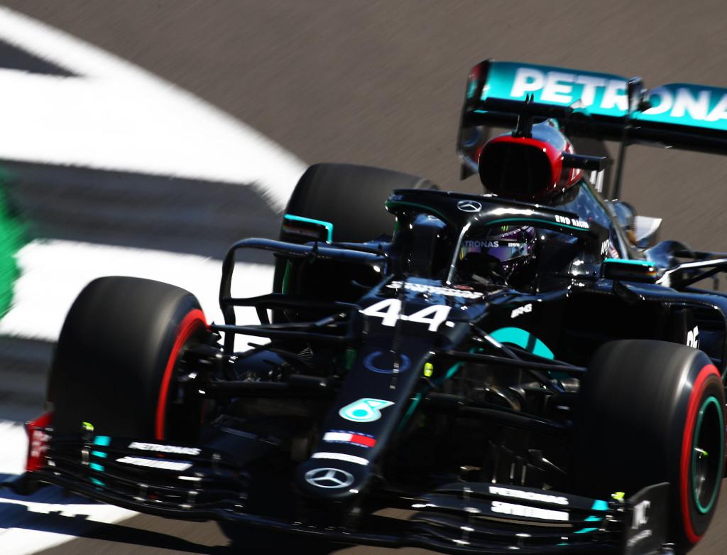 Lewis Hamilton red Pirellis kerb