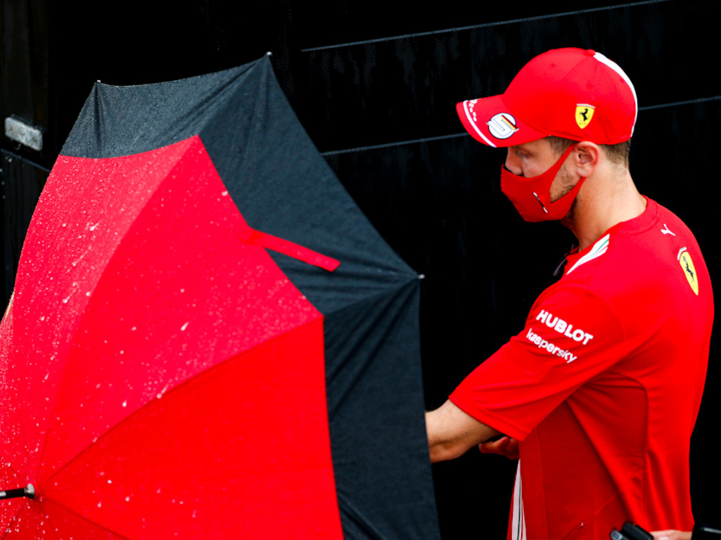 Sebastian Vettel umbrella rain