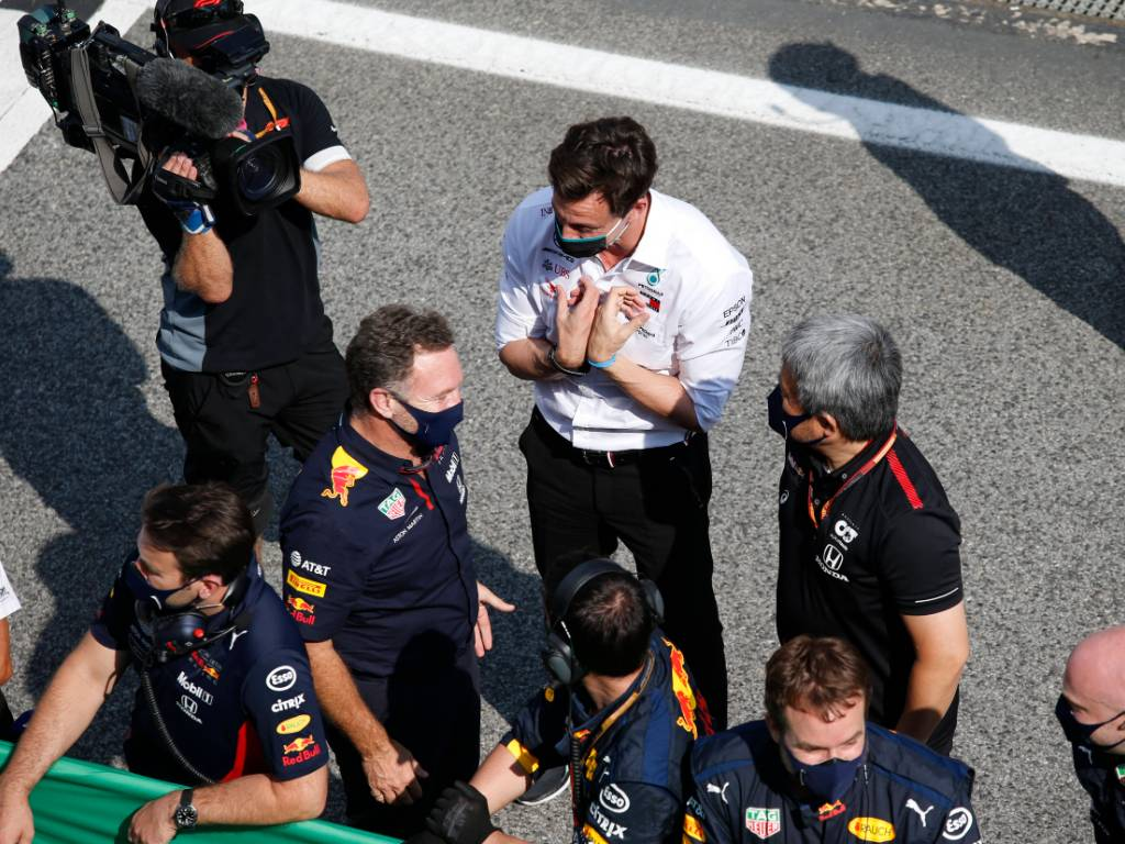 Toto Wolff makes a point to Christian Horner