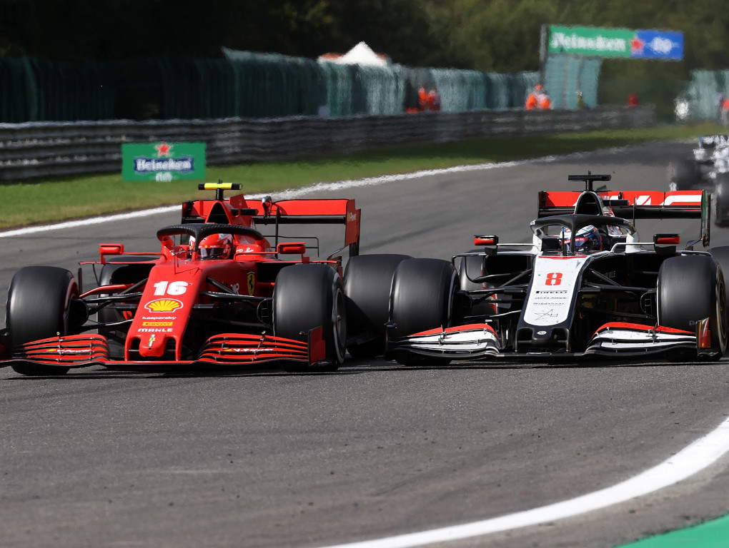 Charles Leclerc fights a Haas