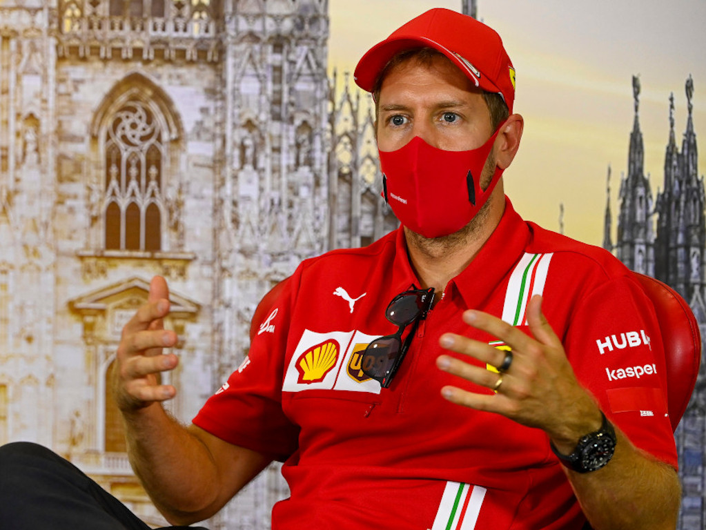 Sebastian Vettel explaining
