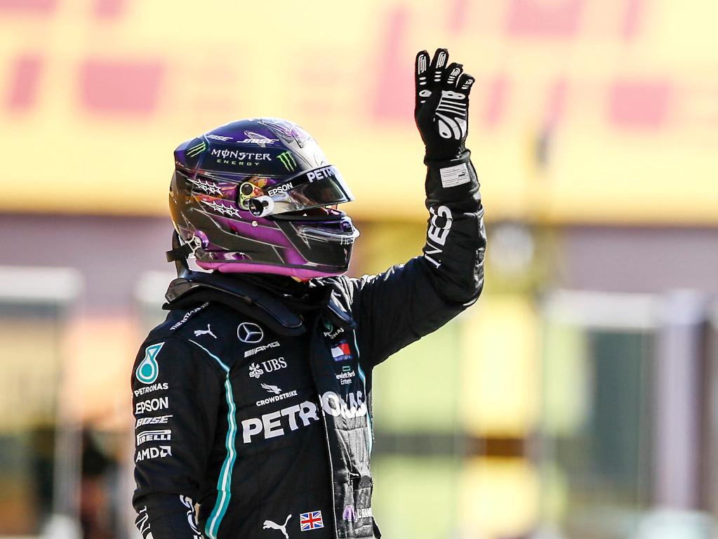 Lewis Hamilton waves