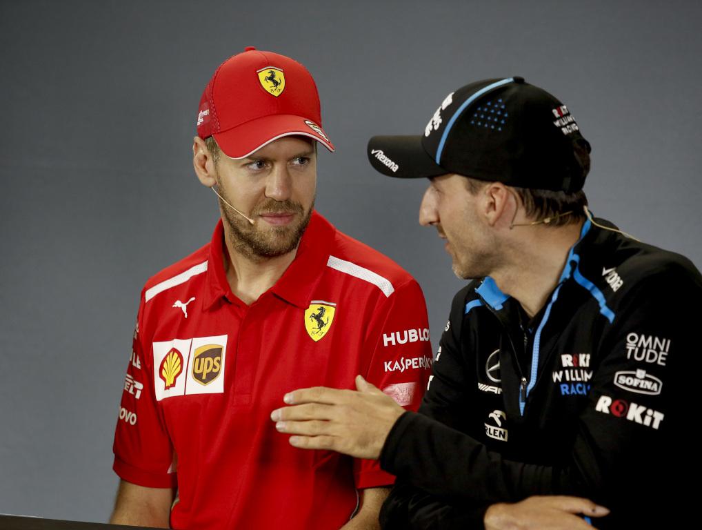 Sebastian Vettel and Robert Kubica.jpg
