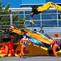 Carlos Sainz's McLaren is craned away after his accident in the Russian Grand Prix