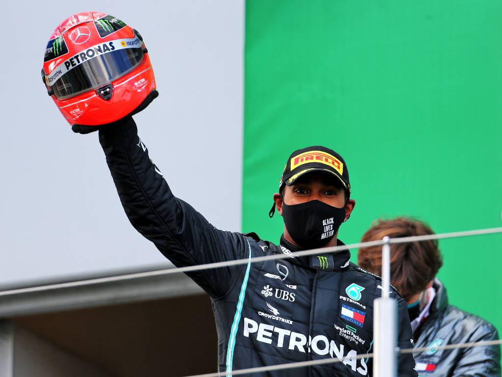 Lewis Hamilton with Michael Schumacher helmet