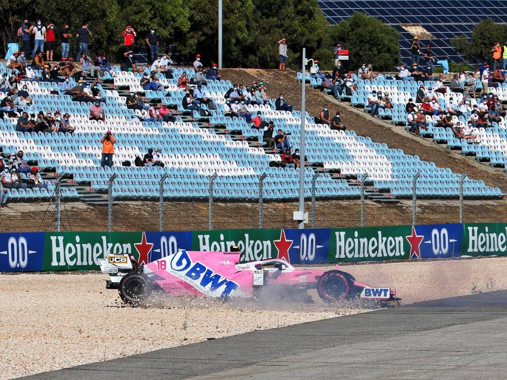 Lance Stroll spins his Racing Point into the gravel after colliding with Max Verstappen during FP2 for the Portuguese Grand Prix