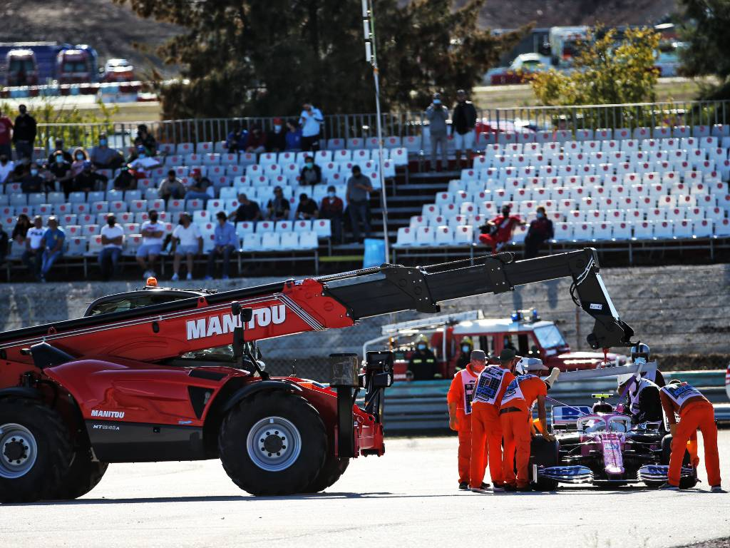 Lance Stroll's Racing Point is craned away after he spun out of FP2 for the Portuguese Grand Prix after colliding with Max Verstappen