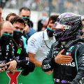 Lewis Hamilton celebrates with the Mercedes team after winning the Portuguese Grand Prix