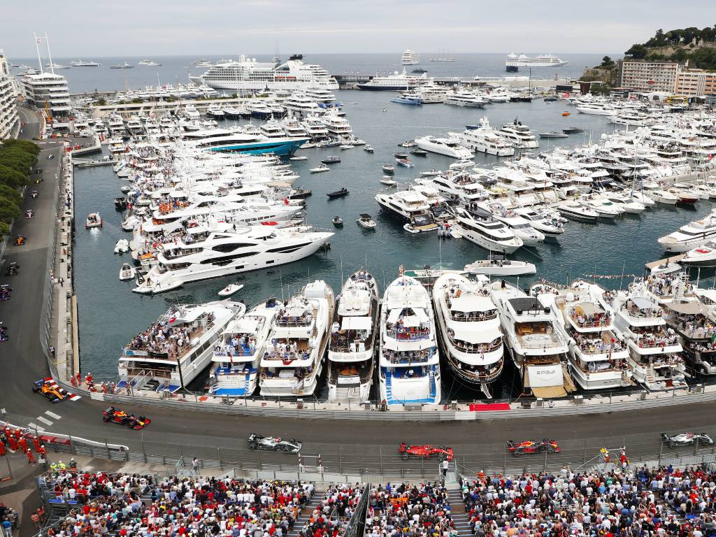 Formula 1 cars pass the harbour during the Monaco Grand Prix