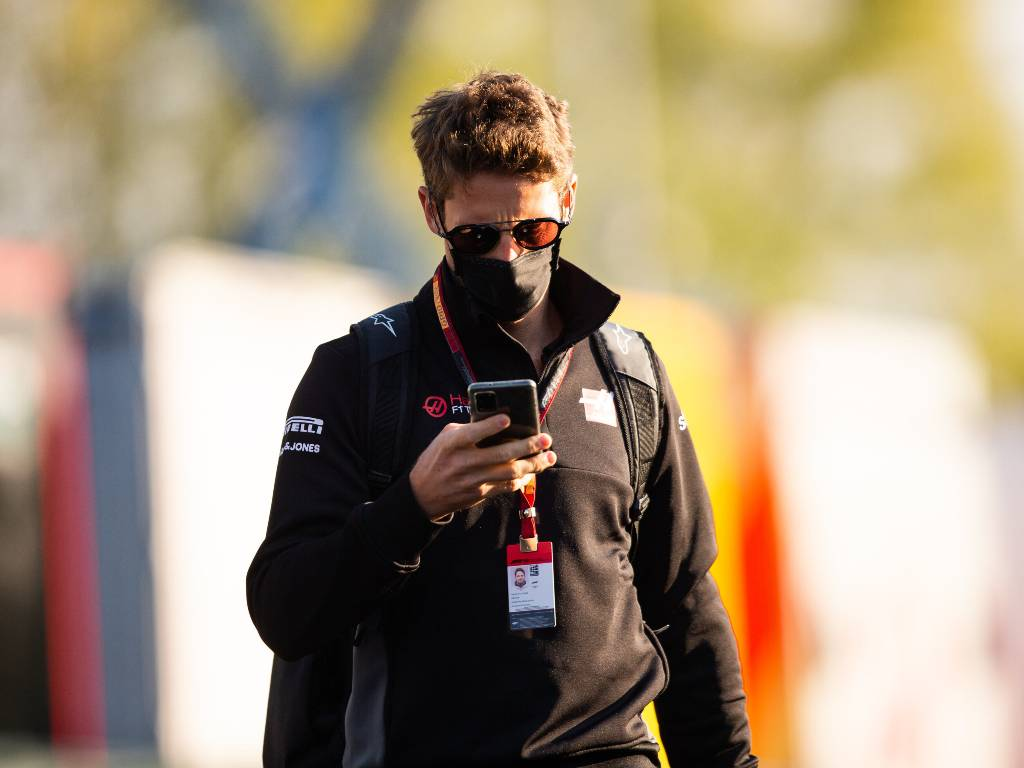 Romain Grosjean checks his phone