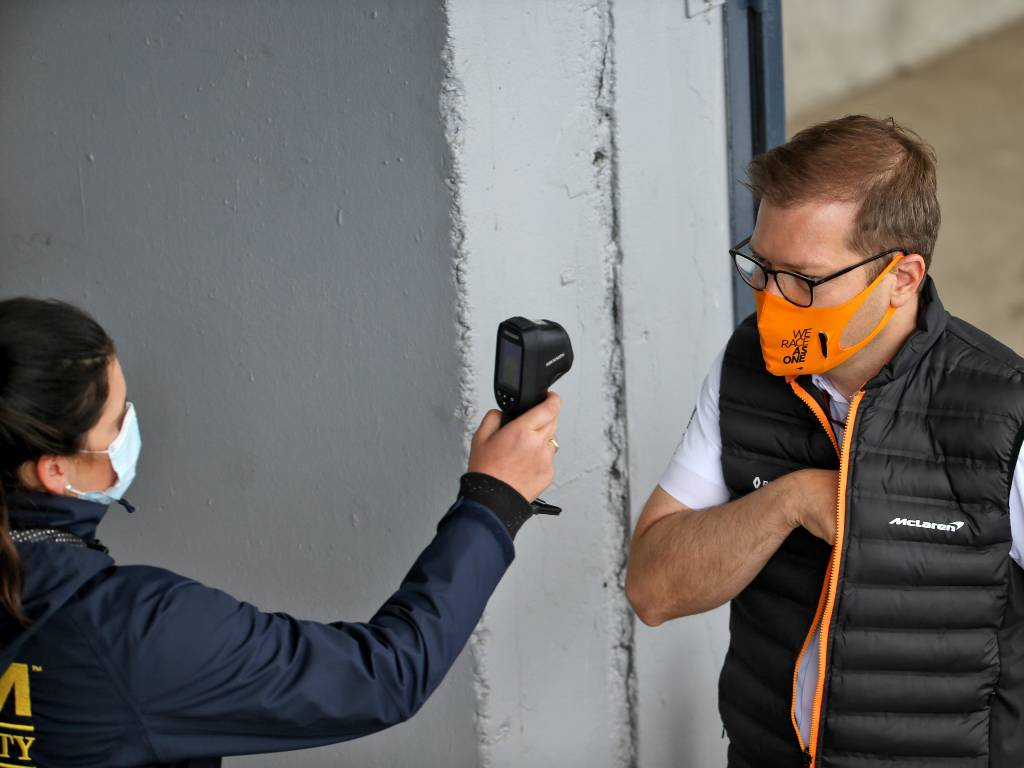 McLaren team principal Andreas Seidl has his temperature checked