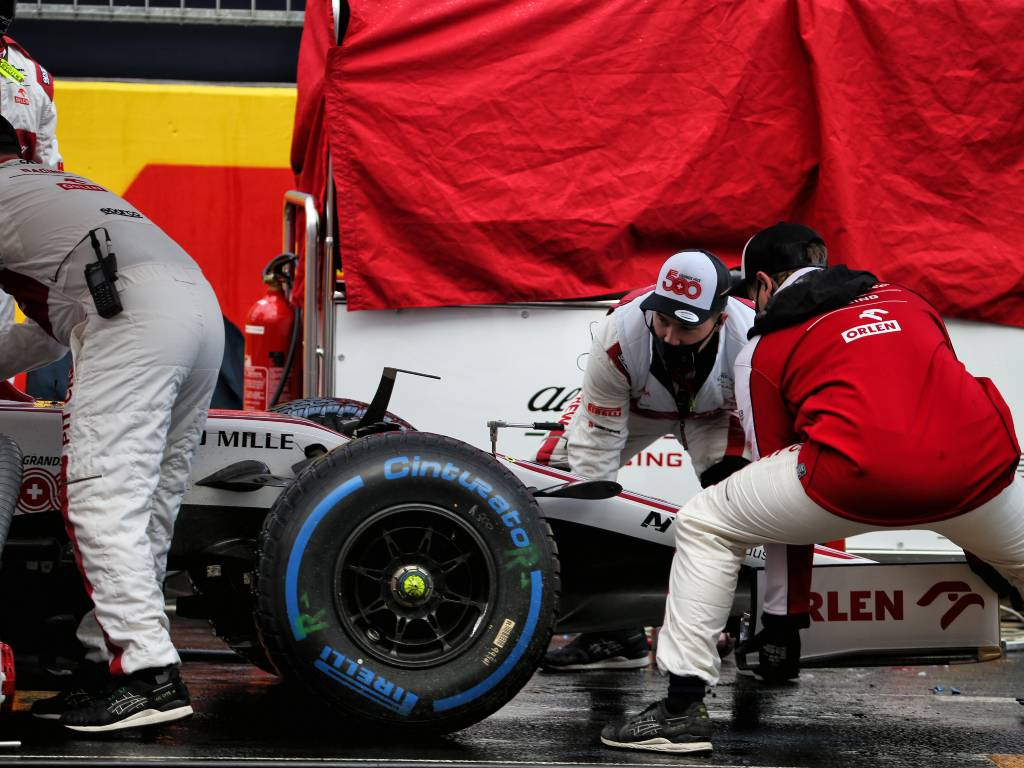 Alfa Romeo mechanics replace Antonio Giovinazzi's front wing on the grid before the Turkish Grand Prix