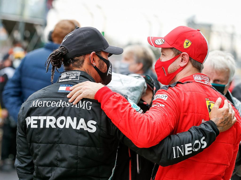 Sebastian Vettel congratulates Lewis Hamilton