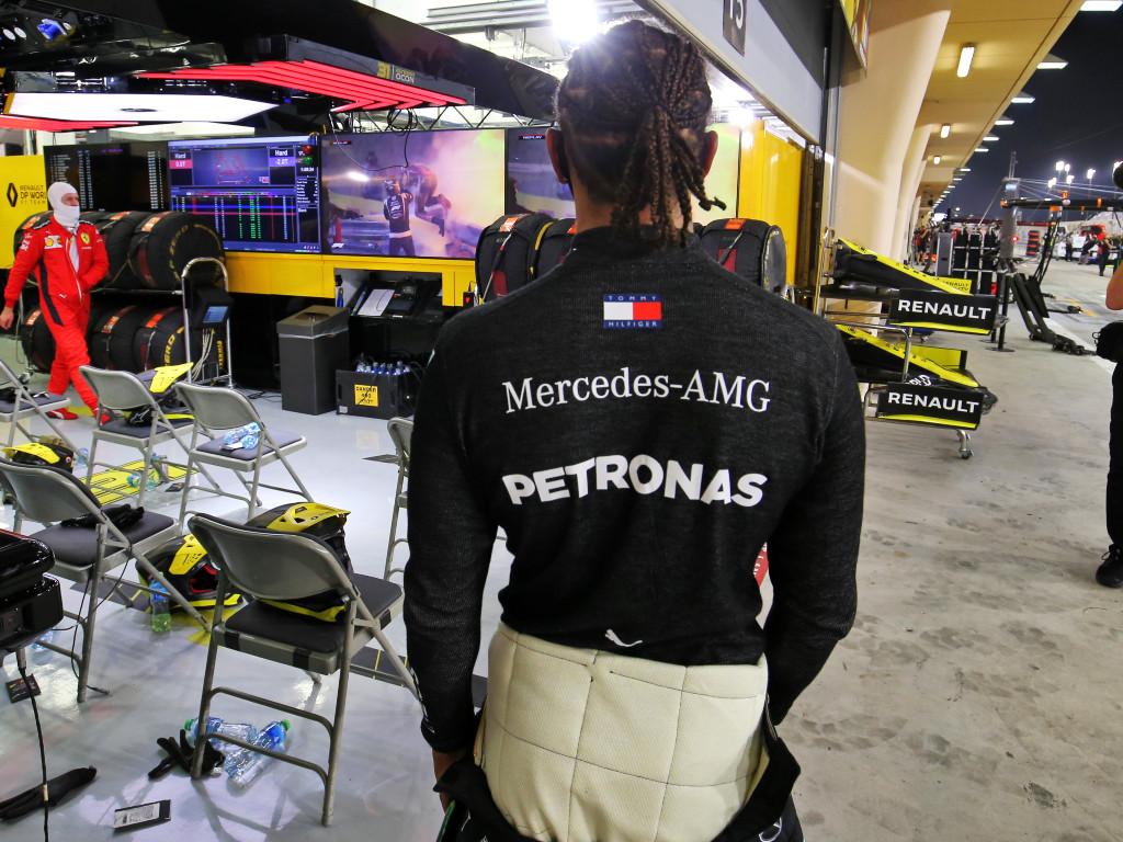 Lewis Hamilton watches Romain Grosjean crash.