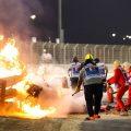 Marshals extinguish the fire in Romain Grosjean's car the Bahrain Grand Priix