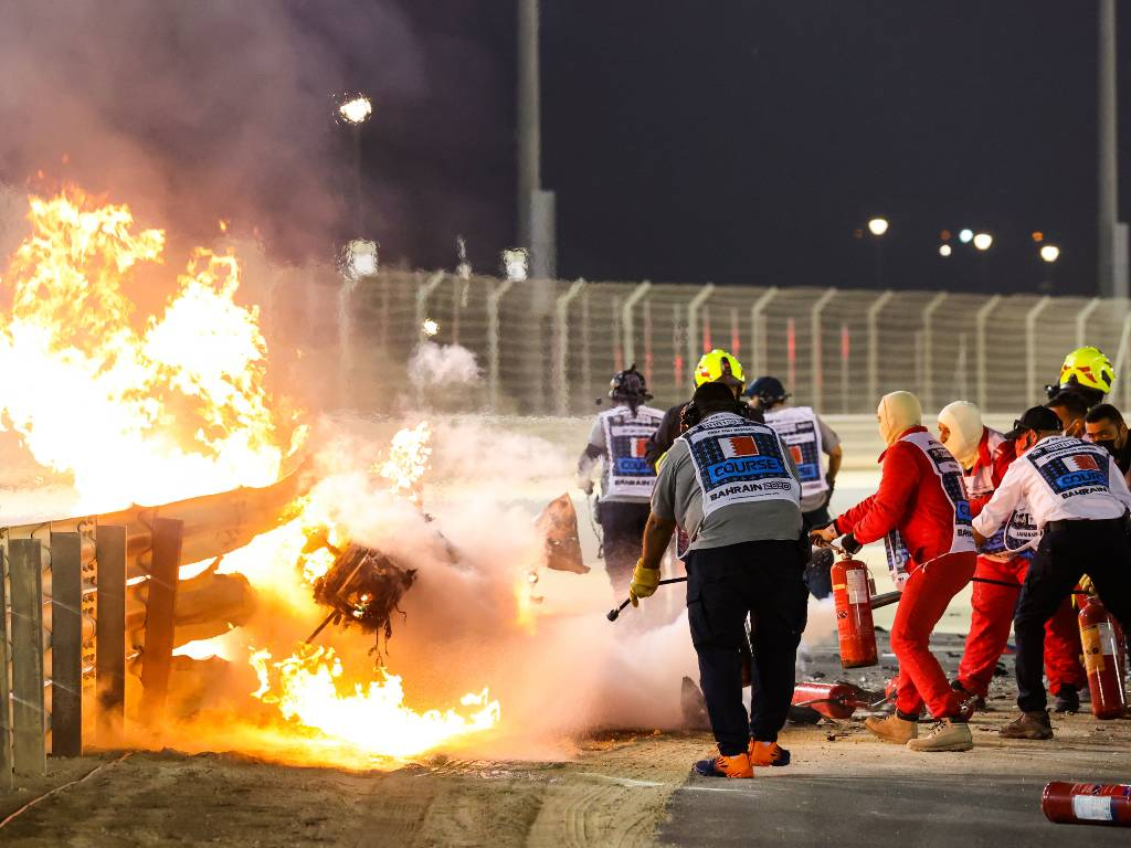 Marshals extinguish the fire in Romain Grosjean's car the Bahrain Grand Priix