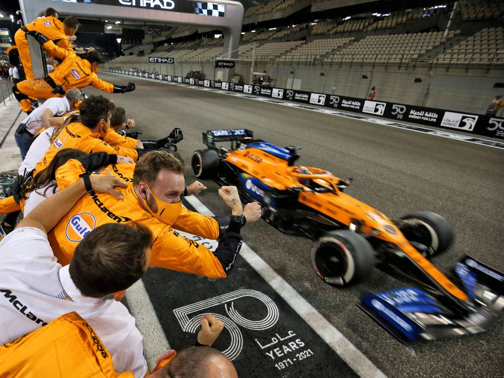 Carlos Sainz crosses the line as McLaren celebrate P3 in the constructors' World Championship