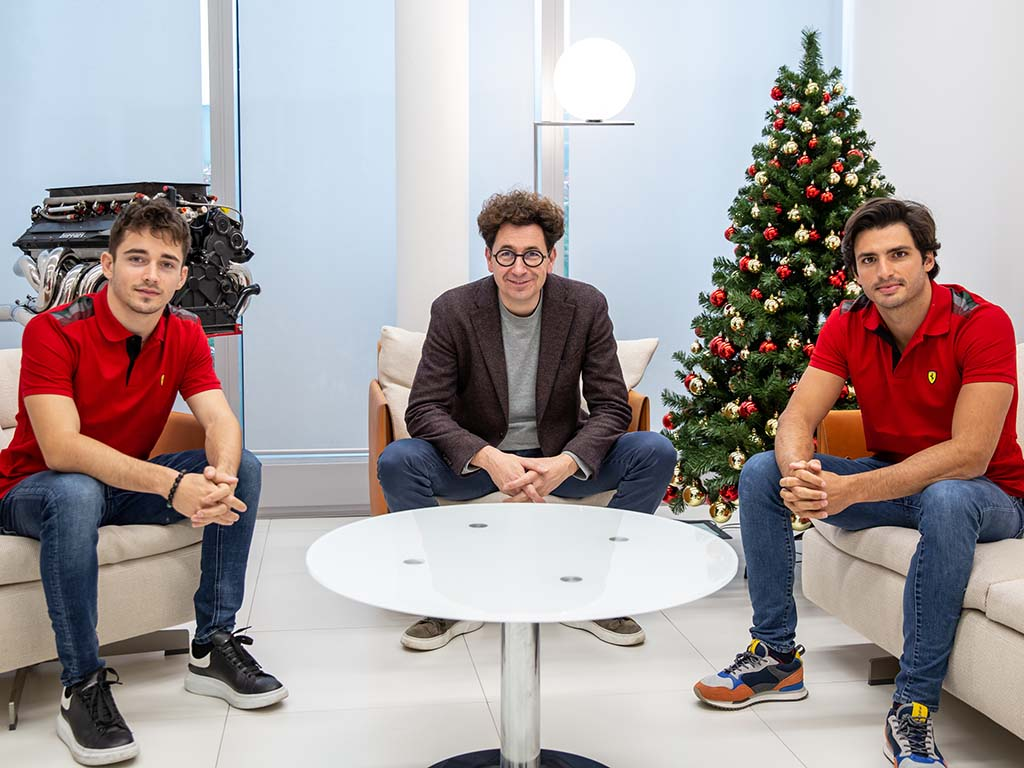 Charles Leclerc, Mattia Binotto and Carlos Sainz of Ferrari
