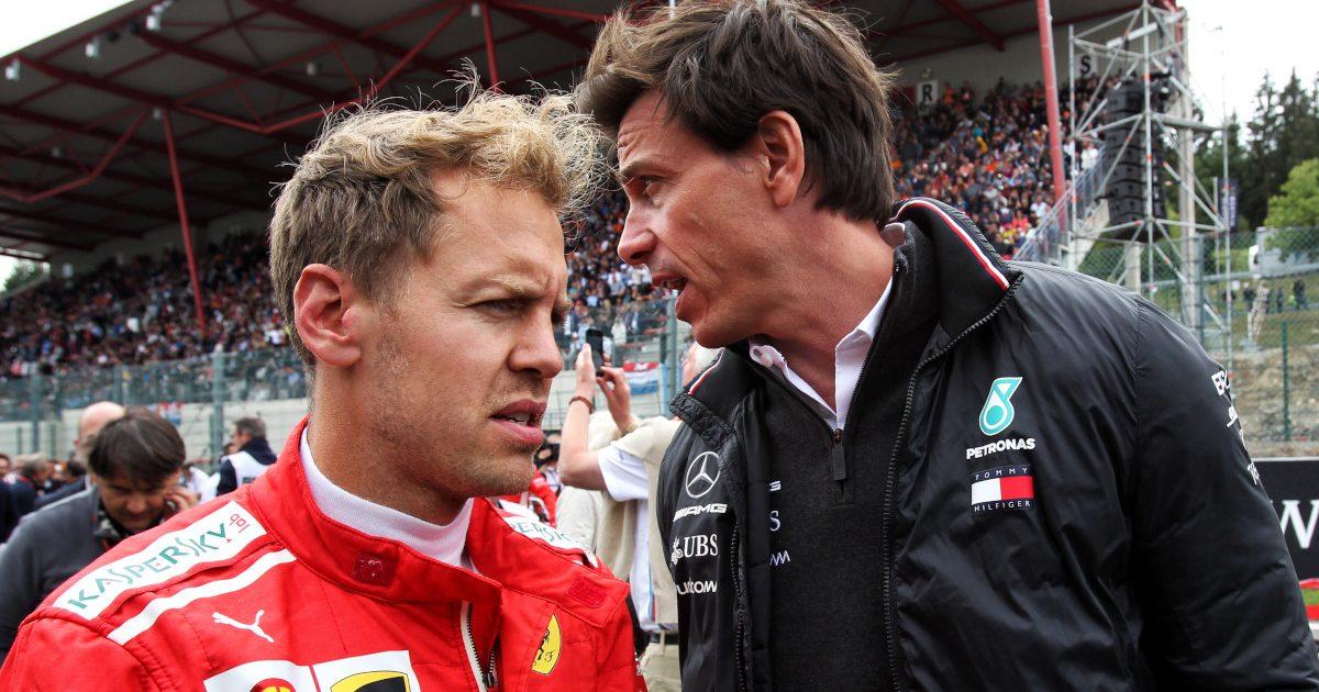 Sebastian Vettel and Toto Wolff