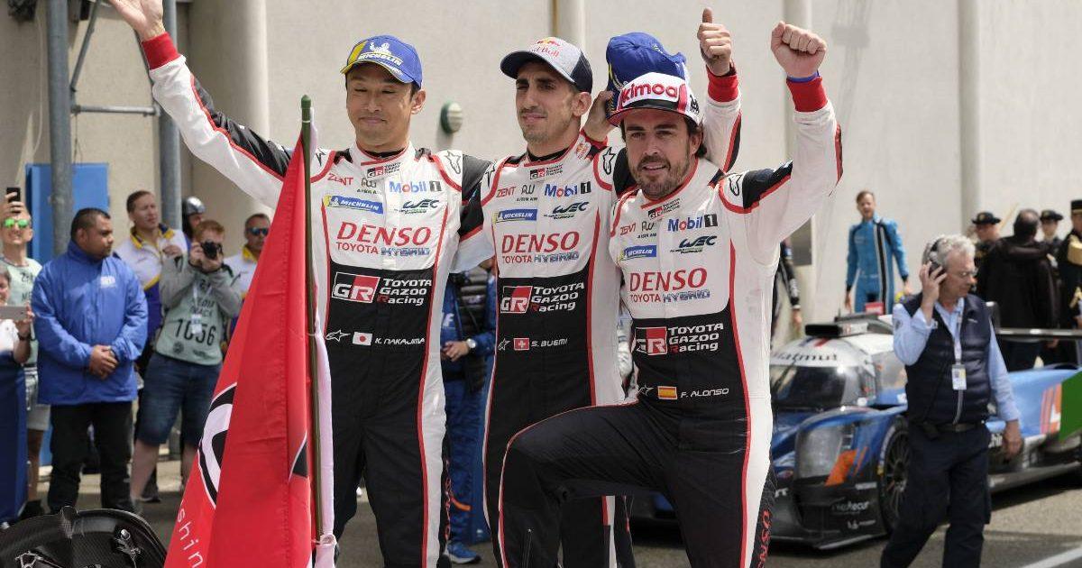 Fernando Alonso (right), Sebastien Buemi (centre) and Kazuki Nakajima celebrate their 2019 Le Mans 24-Hour Race victory