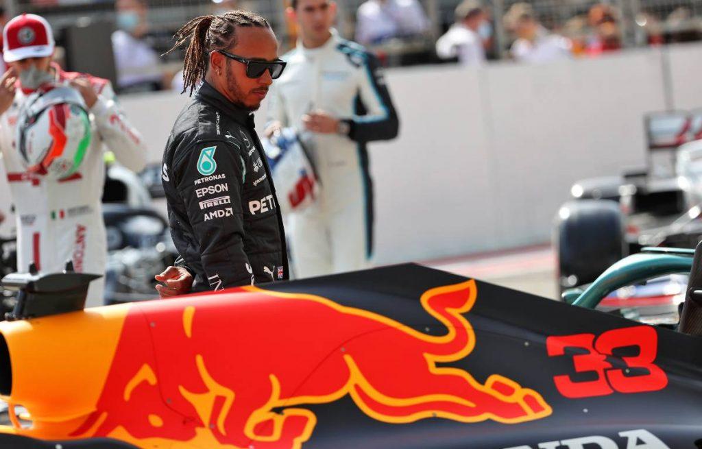 Lewis Hamilton looks at Max Verstappen's Red Bull in Bahrain 2021