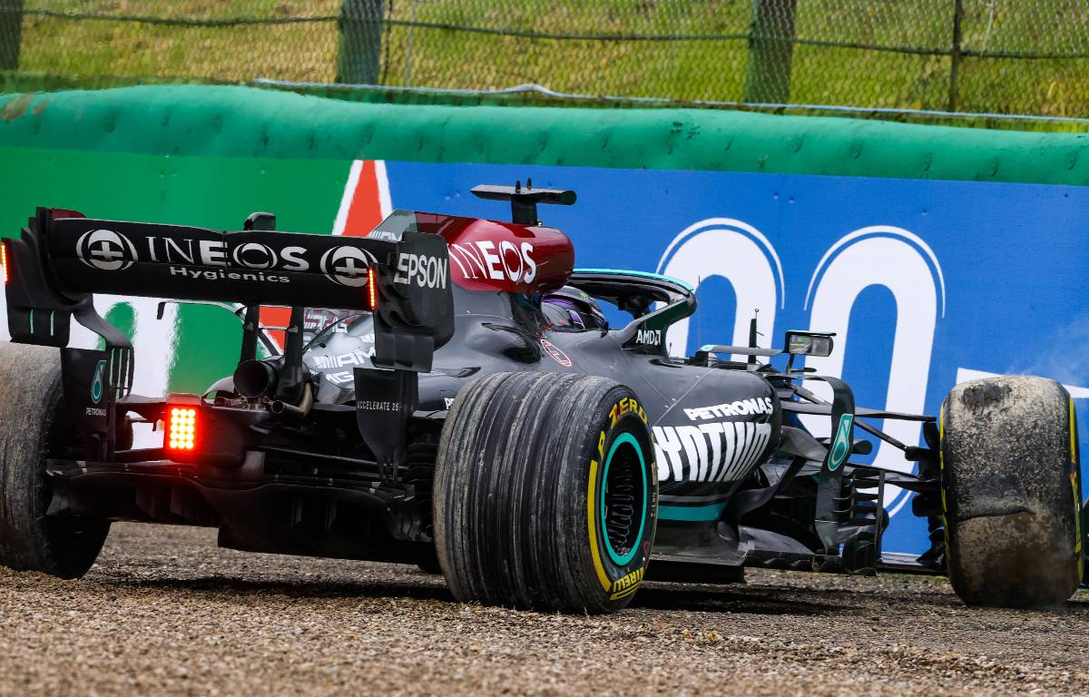 Lewis Hamilton's Mercedes up against the barrier in the Emilia Romagna Grand Prix at Imola before reversing out