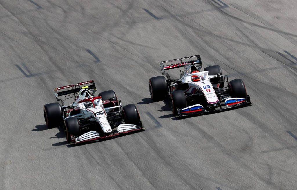 Nikita Mazepin (Haas) overtakes Antonio Giovinazzi (Alfa Romeo) during qualifying at Imola